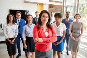 hispanic-businesswoman-and-her-business-team-FYR89ZP
